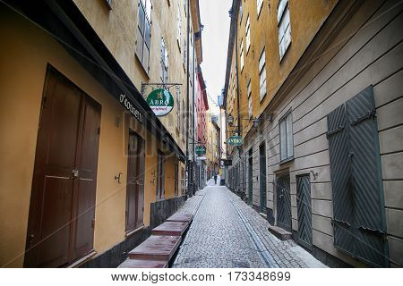 STOCKHOLM SWEDEN - AUGUST 20 2016: View of narrow street and colorful buildings Kakbrinken street located in Gamla Stan old town in central Stockholm Sweden on August 20 2016.