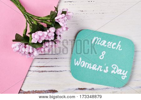 Card and bunch of flowers. Warm greetings with Women's day.