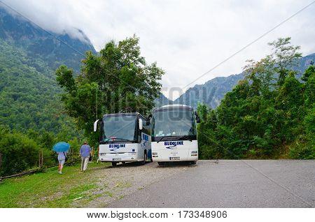 KOLASIN MONTENEGRO - SEPTEMBER 20 2015: Unidentified people go to sightseeing buses in mountainous area Kolasin Montenegro
