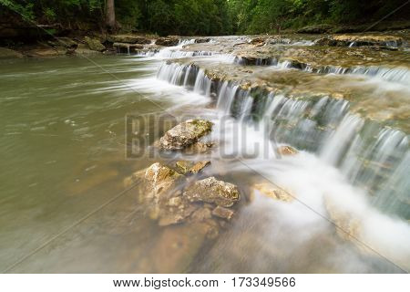 Cascading waterfall on a creek in Lee's Summit Missouri which is a suburb of Kansas City Missouri