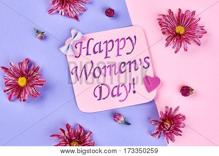 Chrysanthemums and greeting card. Romantic surprise for Women's day.