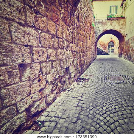Narrow Street with an Arch in the Medieval Italian City Instagram Effect