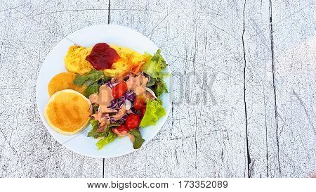 Honey Pancake And Omlet With Vegetable Salad