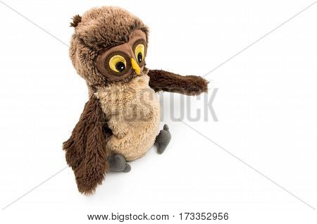 toy owl is laying on the white background