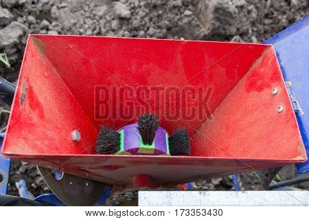 empty seed hopper hand seeder in agriculture field