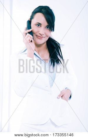 Attractive Young Woman Having Negotiations By Phone In Office