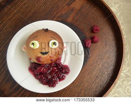 Roll in the form of the boy and raspberry jam. Creative food for children.