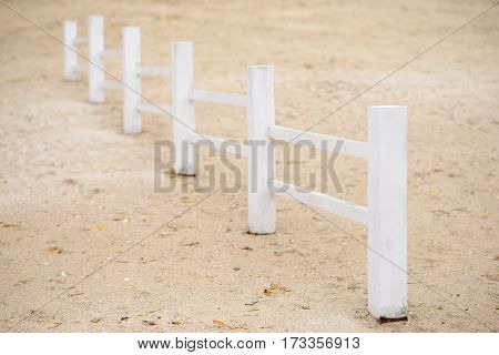 Wooden Fence On A Beach On A Cold Autumn Day