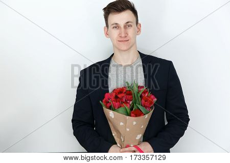 Young Man With Tulips, Bouquet Of Spring Flowers