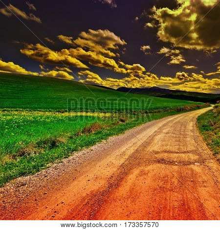 Dirt Road Leading to the Farmhouse in Tuscany Italy at Sunset