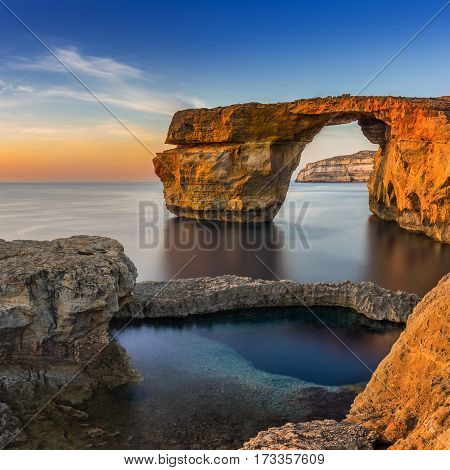Gozo Malta - Sunset at the beautiful Azure Window a natural arch and famous landmark on the island of Gozo