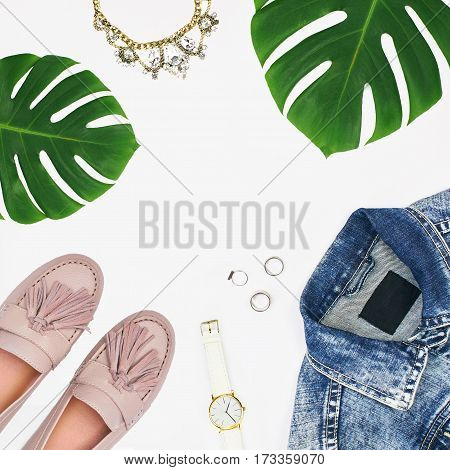 Top view of women's fashion set of accessories isolated on white background. Flat lay composition with space for copy