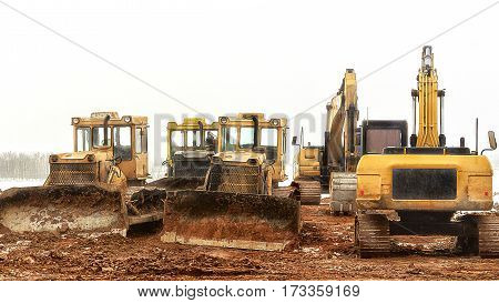 Construction machinery. Construction in winter. Home construction