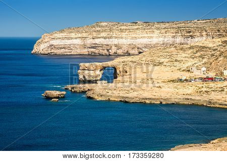 Gozo Malta - The Azure Window and Dwejra bay on a beautiful summer day with clear blue sky