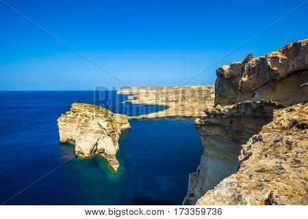 Gozo Malta - Tha beautiful Fungus Rock on the Island of Gozo with the Azure window at background and clear blue sky