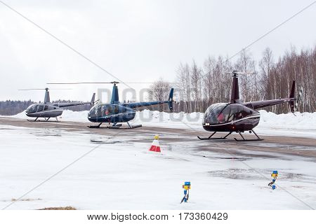 Small helicopter arrived at the airport in winter
