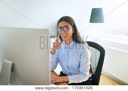 Smiling Small Business Owner On Phone At Work