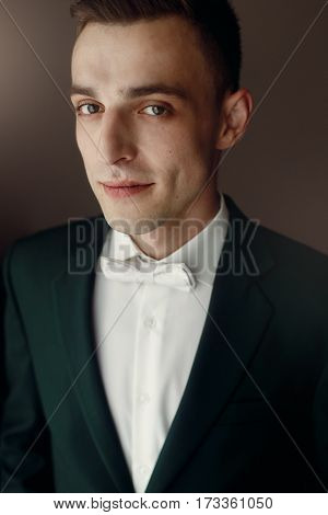 Smiling, Handsome Brunette Groom In Stylish Suit And White Bowtie Posing For Portrait, Morning Weddi