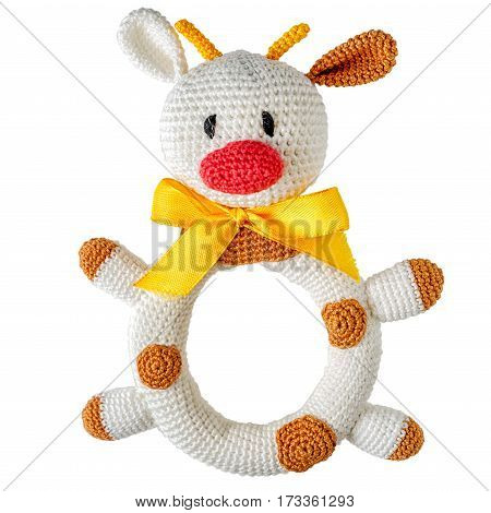 knitted children's toy cow isolated on white background