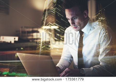 Business Man Sitting At His Desk Working On A Computer