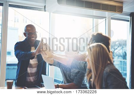 People Giving High Fives To Each Other