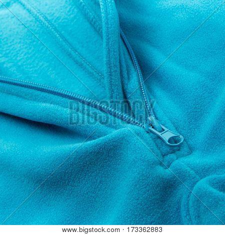 Close up zipper on a blue background fleece