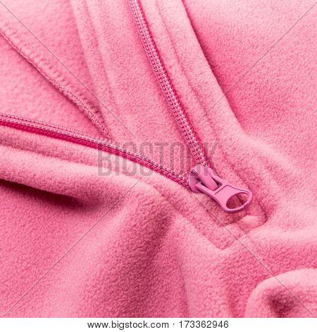 Close up zipper on a red background fleece
