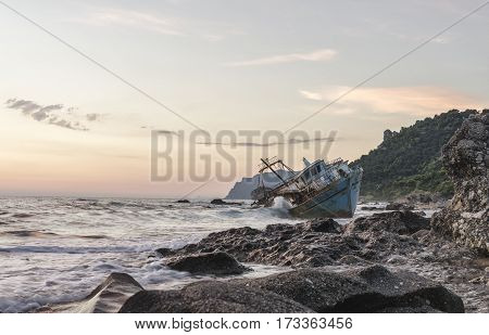 Old Boat On The Sea Beach. Sunset On The Greek Coast