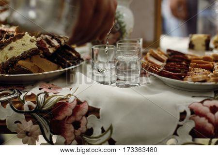 Traditional Ukrainian Wedding Table For Guests Before Ceremony, Stylish Man Drinking And Toasting Vo