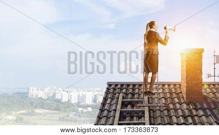 Businesswoman speaking in megaphone . Mixed media