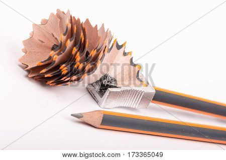 Sharpening Wooden Graphite Pencil Over White Background