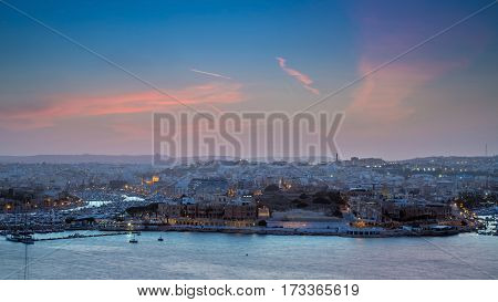 Valletta Malta - Panoramic skyline view from Valletta at sunset with Ta'xbiex Gzira and Mdina yach marina