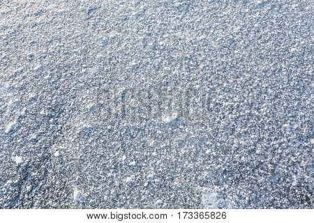 Ice covered with frost and snow. Texture, background