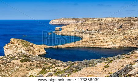 Gozo Malta - The famous Azure Window with the Fungus rock and Dwejra bay on a beautiful summer day with clear blue sky