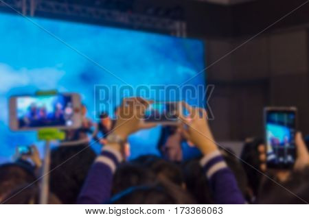 Abstract blur background .Take photo crowd in front of concert stage