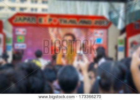 Abstract blur De-focused of concert crowd .
