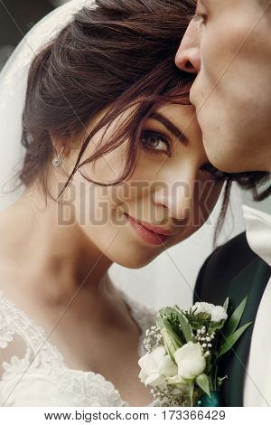 Stylish Handsome Groom Kissing His Lovely Gorgeous Bride. Sensual Tender Moment Of Luxury Wedding Co