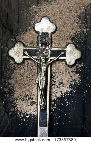 Cross and ash - symbols of Ash Wednesday.