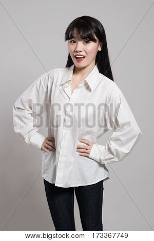Studio portrait of twenties Asian woman in a dignified and happy smile