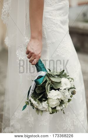 Beautiful Newlywed Bride In Vintage White Lace Wedding Dress Holding White Roses Wedding Bouquet In
