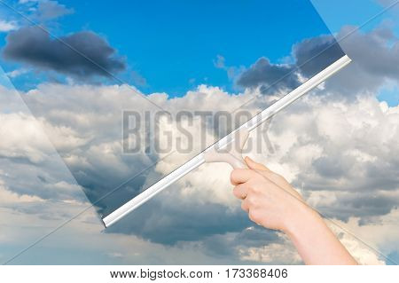 Cleaning Window With Squeegee To Clean The Sky