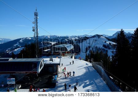Wagrain Austria - January 30 2017: Unidentfied skiers at cable car and chair lift top stations nearby Wagrain and Alpendorf in Alps in Austria.