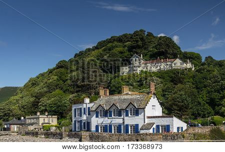 Lynmouth Devon England 13 July 2016: Restaurant and Accommodations - Rock House. Tors Hotel on the hill.
