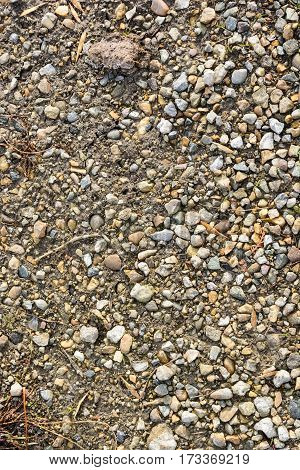 Texture of dirt mixed with gravel and pebbles