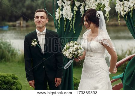 Beautiful Couple At Wedding Ceremony, Handsome Groom In Stylish Suit And Beautiful Bride In White Dr