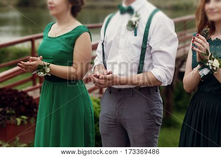 Happy Beautiful Guests At Wedding Ceremony, Stylish Groomsman And Gorgeous Bridesmaids In Green Dres