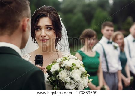 Gorgeous Bride Crying While Making Vows On Aisle At Lake At Wedding Outdoor Reception And Ceremony.