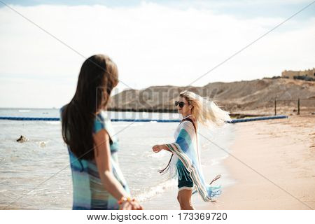 Photo of Two women in beachwear on the beach