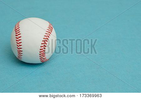 A baseball isolated on a blue background
