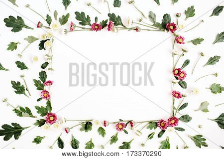 Frame wreath with red and white wildflowers green leaves branches on white background. Flat lay top view. Flower background.